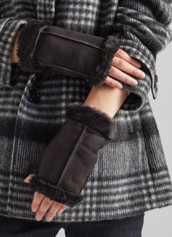 L.K. BENNETT CAITRIN BLACK SHEARLING GLOVES / womens fingerless gloves / women's luxe winter accessories - flipped