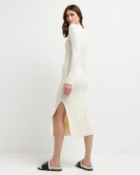 River Island Cream chunky cable knit midi dress   long sleeve high neck split hem knitted dresses   womens on trend knitwear