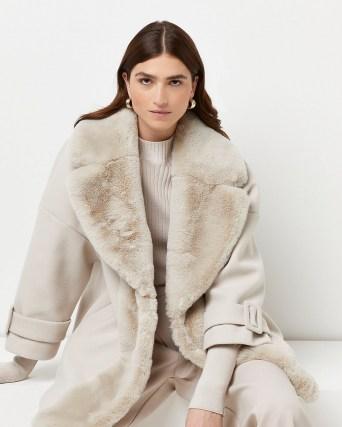 River Island Cream faux fur trim swing coat – women's luxe style winter coats - flipped