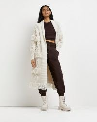 River Island Cream fringe detail cable knit cardigan | longline open front fringed cardigans | Western boho inspired knitwear