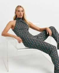 River Island Green geometric print jumpsuit   retro geo print jumpsuits   halterneck going out fashion   halter neck fitted all-in-one