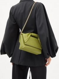 JW ANDERSON Twister green leather shoulder bag | contemporary front flap handbag | chic twisted top handle bags | chain strap handbags