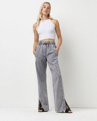 River Island Grey high waisted flared jeans   womens split hem denim trousers   slit hems - flipped