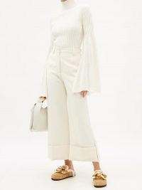 JW ANDERSON Bell-sleeve cotton-knit ribbed sweater   white high neck flared sleeve sweaters   split wide sleeved jumpers   feminine knitwear