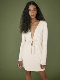 Reformation Karah Dress in Cream | long sleeve plunge front empire waist dresses | deep plunging V neckline | rib knit fashion
