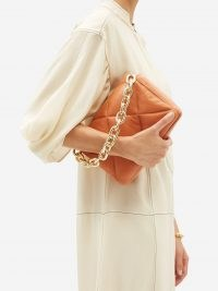 STAND STUDIO Brynn small quilted-leather shoulder bag | orange chunky chain strap handbags | chic flap bags