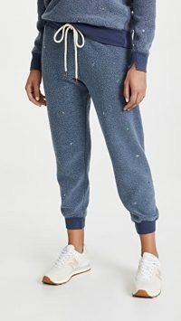 THE GREAT. The Sherpa Cropped Sweatpants with Ditsy Floral Embroidery Vintage Navy / womens blue cuffed joggers / fluffy textured jogging bottoms