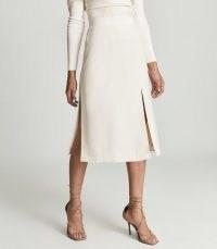 Reiss TONI TONI PENCIL SKIRT CREAM | chic high waist split hem skirts