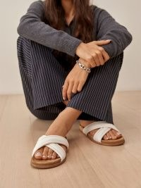 Reformation Arianna Puffy Strap Slide Sandal in White | luxe leather footbed slides | flat crossover sandals