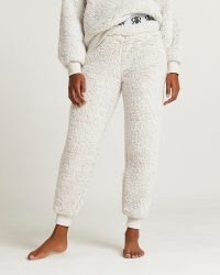 River Island Beige RI branded waistband borg joggers – textured faux shearling cuffed jogging bottoms