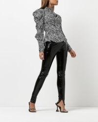 RIVER ISLAND BLACK VINYL SKINNY TROUSERS / shiny split hem skinnys / high shine going out evening fashion