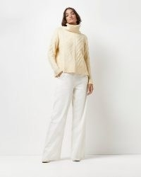 River Island CREAM CABLE KNIT JUMPER | womens chunky high roll neck jumpers