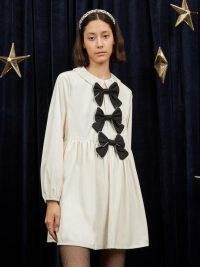 sister jane Pisces Velvet Smock Dress in Buttercream – bow embellished dresses