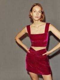 Reformation Harri Velvet Skirt in Rhubarb – luxe front knot mini skirts – evening fashion