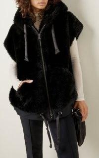 Bogner Ivy Faux Fur Hooded Vest in Black – chic fluffy cap sleeve jackets – womens winter outerwear – women's stylish gilets
