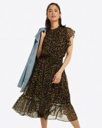 DRAPER JAMES Kacey Faux Wrap in Flower Confetti – black floral semi sheer flutter sleeve dresses – feminine fashion – tiered ruffle hem