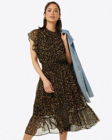 DRAPER JAMES Kacey Faux Wrap in Flower Confetti – black floral semi sheer flutter sleeve dresses – feminine fashion – tiered ruffle hem - flipped