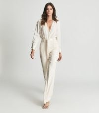 REISS LUKA TUX JUMPSUIT IVORY / luxe evening jumpsuits / glamorous plunge front occasionwear / occasion glamour