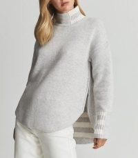 Reiss NAOMI STRIPED TRIM WOOL BLEND JUPMER GREY MELANGE | split curved hem high neck jumpers | slouchy drop shoulder sweaters | womens on trend knitwear