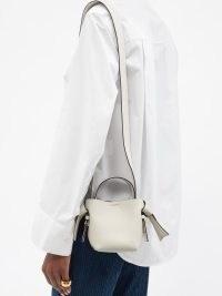 ACNE STUDIOS Musubi micro white leather cross-body bag – cute mini shoulder bags – small top handle crossbody – knotted strap detail handbags